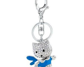 Keychain - bag silver cat with a multitude of rhinestones - blue dress