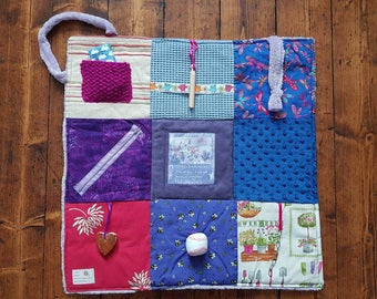 Bespoke fidget blanket for people with Alzheimer's disease or dementia . Busy blanket in shades of lavender. Customize with your own photos.