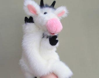 Goat. White goat. Toy glove. Toy on hand. Puppet theatre.Bibabo. Marionette.