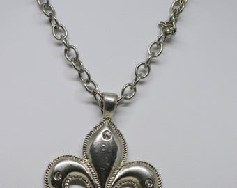 Large silver tone necklace with pendant