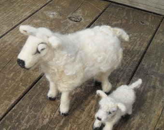 Needle felted Sheep and lamb sculptures.
