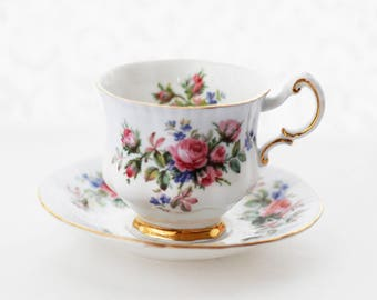 PARAGON by appointment to Her Majesty  teacup and saucer, pale blue band, sweet pink and red roses, goldgilt rims, 1970