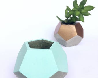 A handmade geometrical concrete planter