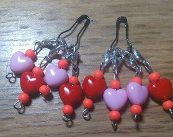 Set of four heart stitch markers on a light bulb pin.