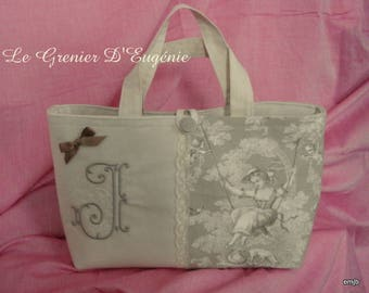 French toile de Jouy bag embroidered with a monogram * J *.