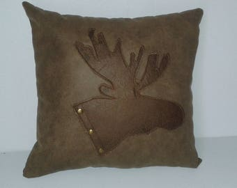 ranch or mountains with deer head cushion