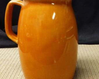 Orange drip pitcher Oven Proof made in USA in mid to late 1900s