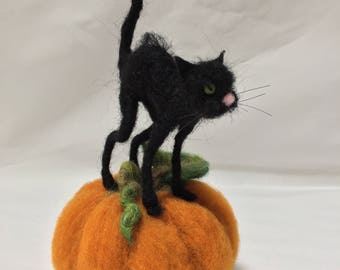 Needle Felted Black Cat standing on Pumpkin