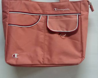 Nice!! Champion // Handbag// Peach Color// With Nice Pocket// Spellout Big Logo// well Designed// Champion products