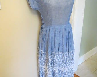 Soft Blue Dress with Floral Details