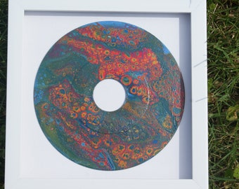 Acrylic, multimedia painting on a recycled vinyl record