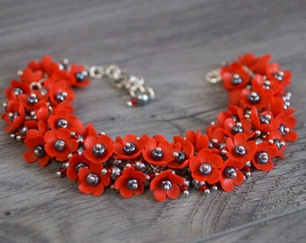 Bracelet with red flowers from polymer clay
