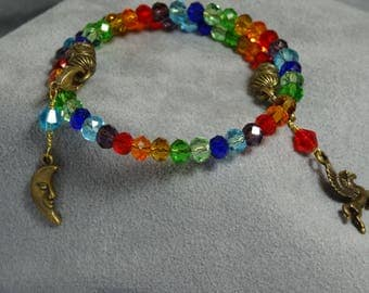 Rainbow memory wire bracelet with brass moon and Pegasus horse charms