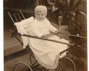 Old snapshot little baby boy in huge pram bassinet funny curiosa 1930s fashion Romania Europe vintage photo children toys RPPC