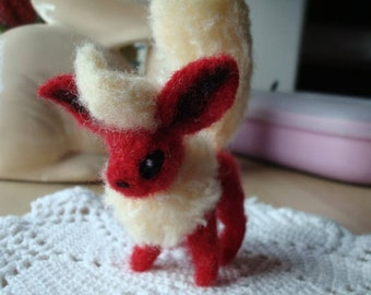 Small needle felted Flareon (Pokémon) soft sculpture