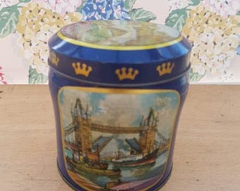 Vintage tin, Scribbans Kemp chocolate table fingers. Featuring historic landmarks; Tower Bridge, Giant's Causeway, Aberdeen, Cardiff.