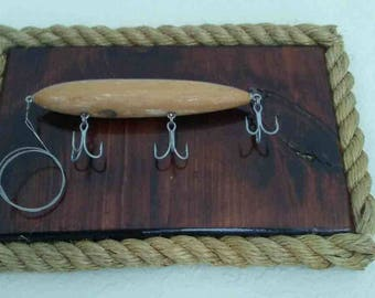 Unique display of antique wooden fishing lure