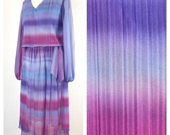 Beautiful floaty vintage, long sleeved midi dress. Size 12
