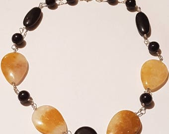 Calcite and onyx gemstone necklace. 18 inches long