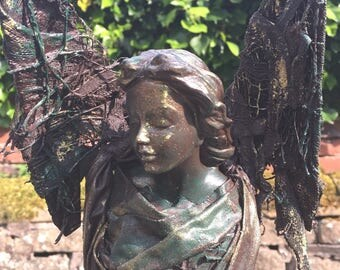 Our beautiful hand made sculpture, Angel Dina.
