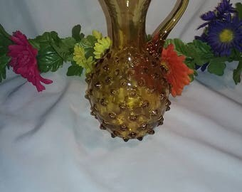 Vintage Amber glass pitcher with knobs.Amber glass Spike seed pitcher.