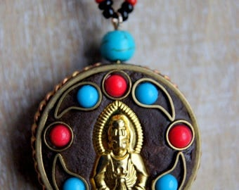 Seed beads and turquoise Buddhist amulet necklace