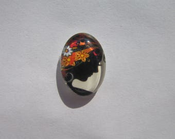 Oval glass cabochon 13 X 18 mm with a black woman image