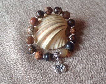 Stretch bracelet, different Brown gemstones and silver beads.