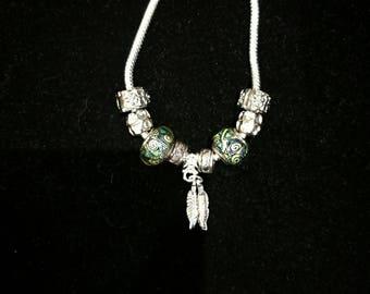 European bracelet with Green European beads, feathers