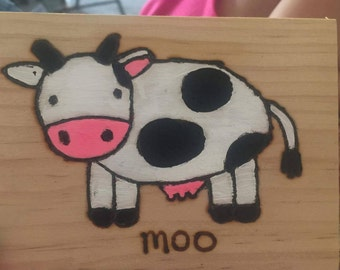 Cow painted wood burning