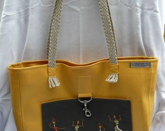 Large bag with outside pocket embroidered faux straps