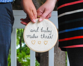 "Pregnancy Announcement Embroidery Hoop, Customizable, ""And Baby Makes Three"", Gender Reveal, Pregnancy Reveal, Parents-to-be"