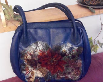 Lady's shoulder leather bag with  floral  pattern