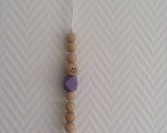 Purple pacifier clip