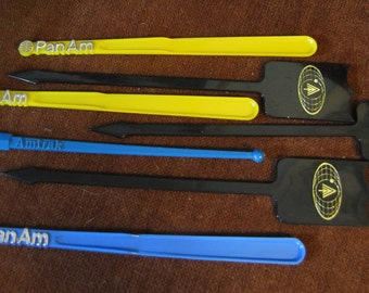 Set of 7 Vintage Amtrak, PanAm, and Travel Swizzle Sticks - circa 1960s