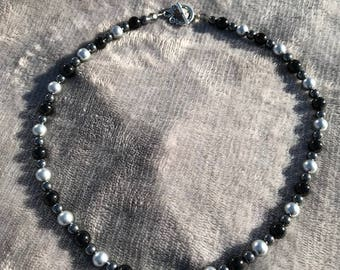 Necklace of Gray Swarovski beads, Onyx Beads and Hematite Beads with matching Pierced Earrings