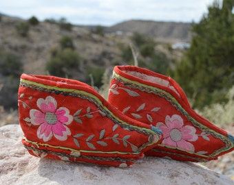 Pair of vintage Chinese women's Lotus shoes from a time when women's feet were bound to keep them small.  Hand sewn, embroidered.