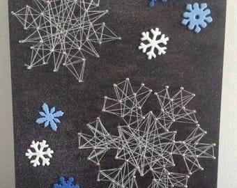 Snowflake wood string art