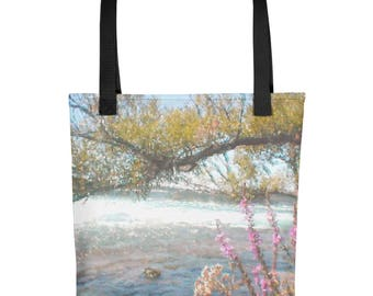 """Tote Bag: Watercolor landscape """"By the Flowing River"""" by Malinee Ganahl. Pink flowers and tree branch by water's edge."""