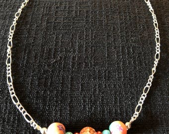 Fun and stylish beaded necklace on a bright silver chain just in time for Spring!