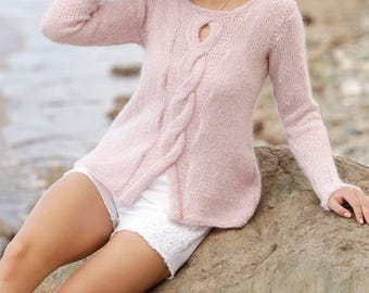 Romantic cable sweater with a twist
