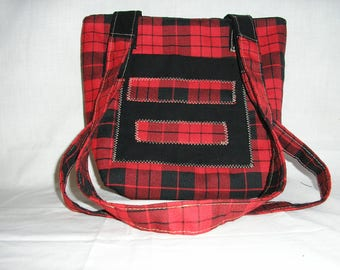 Red and black checkered bag