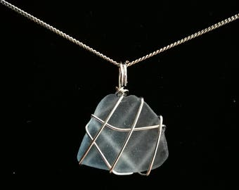Wire wrapped pale blue sea glass pendant