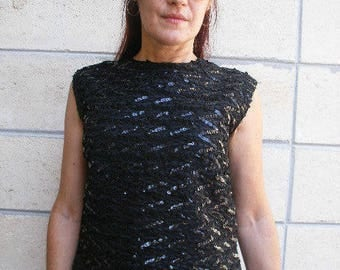 60s black sequin top. Sleeveless sheath top in inky black sequins, size S-M.
