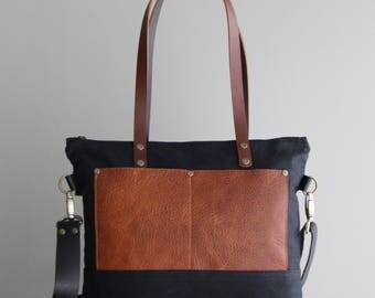 Medium Waxed Canvas Tote in Black with Cognac Leather Pockets and Handles Cross Body Strap