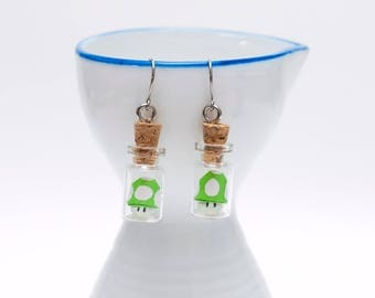 Origami Mario Bros green shroom earrings in tiny glass bottle