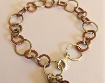 Bracelet circles of hammered copper and silver.