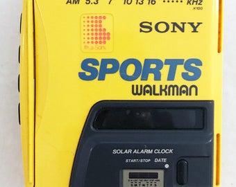Vintage Sony Walkman Sports WM-AF58 Cassette Solar Power Alarm Clock AM/FM Tested Works Yellow