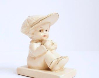 Coventry ware boy photographer figurine