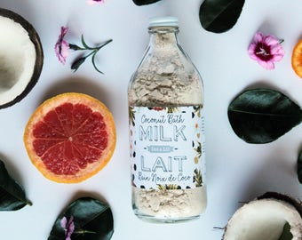 coconut milk bath luxurious vegan moisturizining formula in glass apothecary bottle